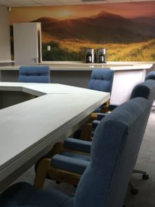 Completed boardroom. All woodwork painted, new carpeting, wallpaper, paint effecting of boardroom tables and serving area as well as a customised wallpaper mural.