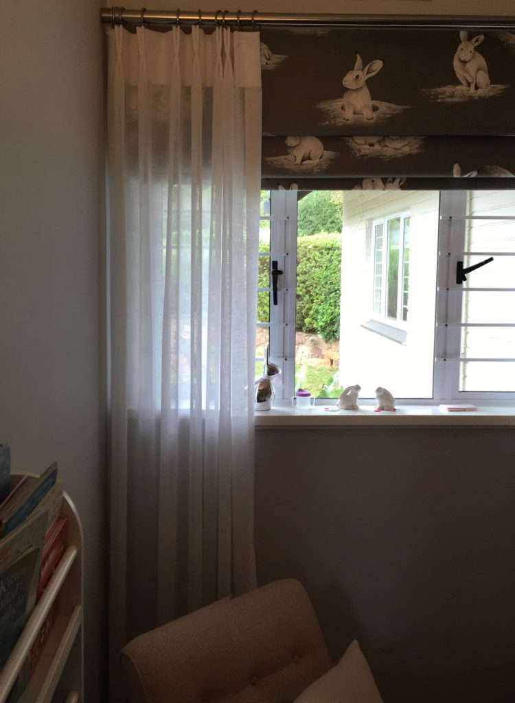 Peter Rabbit blind with white sheer curtains